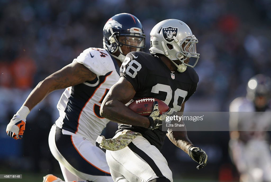 Latavius Murray #28 of the Oakland Raiders gains yardage in the third quarter against the Denver Broncos at O.co Coliseum on November 9, 2014 in Oakland, California.