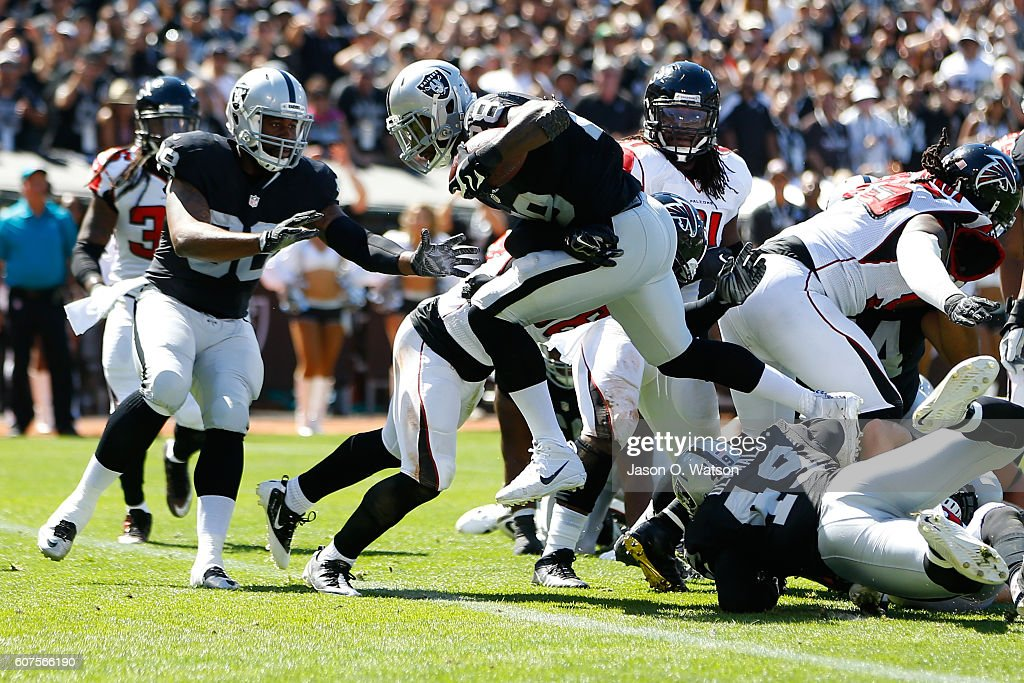 Latavius Murray #28 of the Oakland Raiders scores a 1-yard touchdown during their NFL game against the Atlanta Falcons at Oakland-Alameda County Coliseum on September 18, 2016 in Oakland, California.
