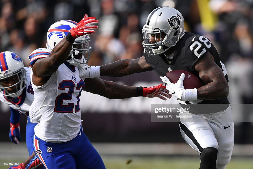 Latavius Murray #28 of the Oakland Raiders stiff-arms James Ihedigbo #27 of the Buffalo Bills during their NFL game at Oakland Alameda Coliseum on December 4, 2016 in Oakland, California.