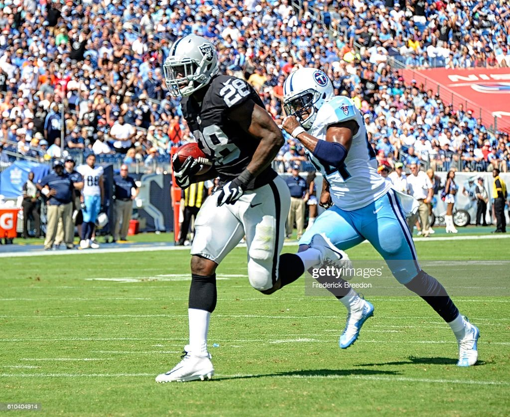 Latavius Murray #28 rushes for a touchdown against of the Tennessee Titans during the first half at Nissan Stadium on September 25, 2016 in Nashville, Tennessee.
