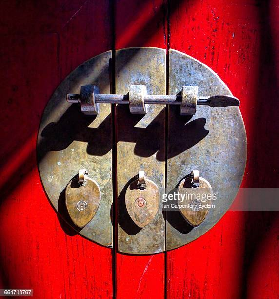 Latch On Closed Door Of Red Cabinet At Home