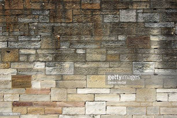 late 19th century sandstone surrounding wall - sandstone stock pictures, royalty-free photos & images