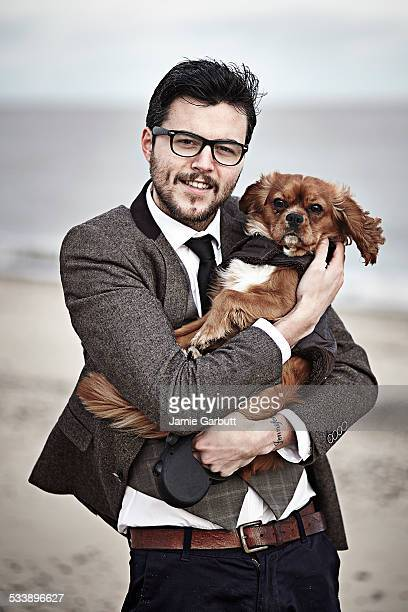 Late 20's male with his dog on the beach
