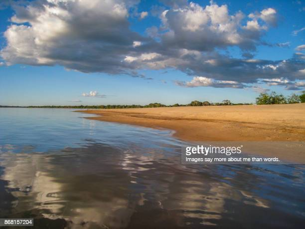 Late afternoon at Araguaia River. Landscape with low clouds.