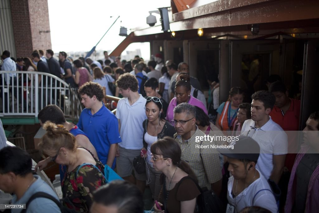 Late afternoon commuters disembark from the Staten Island Ferry June 20, 2012 at the St. George Terminal in Staten Island, NY. The Staten Island Ferry makes the 5.2-mile journey between New York's financial district and the St. George Ferry terminal in 25-minutes and carries 21 million passengers annually.
