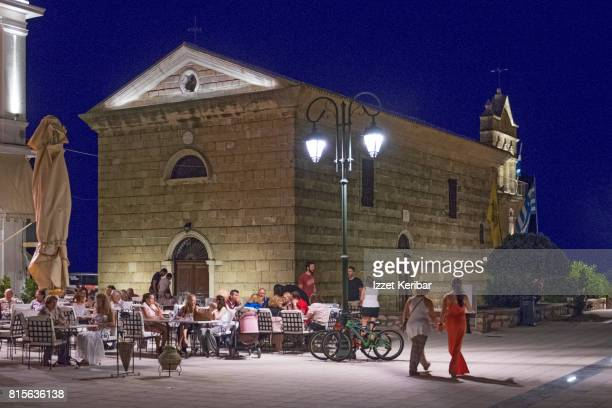 Late afternoon picture of Solomos square, with people walking or sitting around , Zakynthos island, Ionian islands, Greece