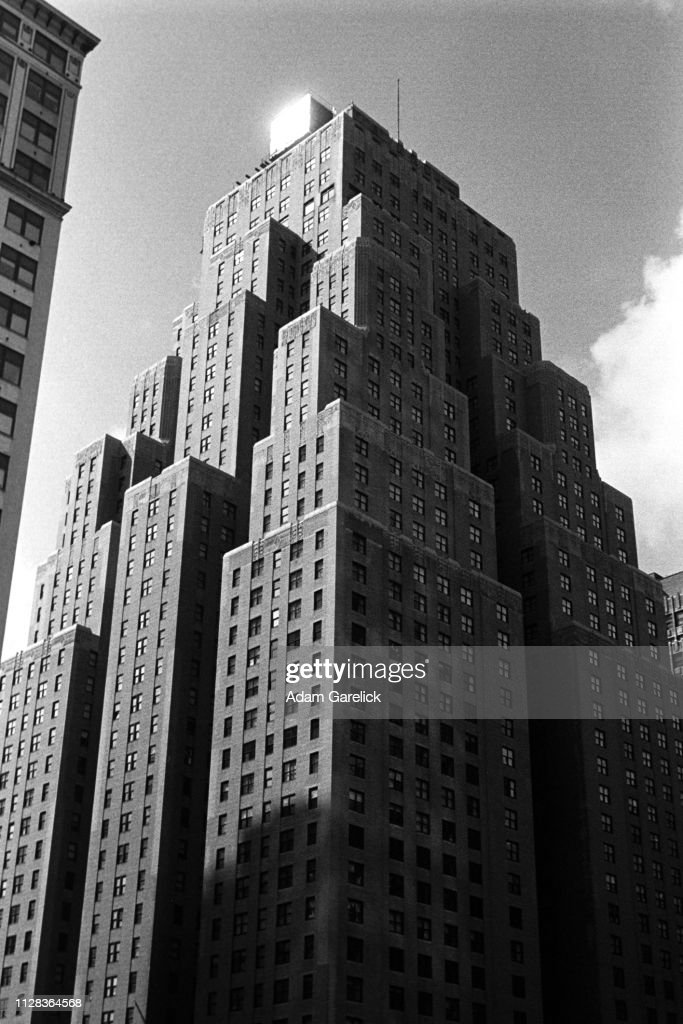 Late Afternoon Shadows Shroud the New Yorker Building in Manhattan, New York City : Stock Photo