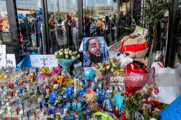 LOS ANGELES CA APRIL 02 2019 LAPD late afternoon started letting mourners groups of 25 to visit makeshift memorial for Nipsey Hussle at his store The...