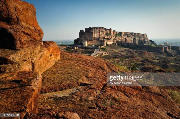 Late afternoon sun shining on the enormous Mehrengarh Fort in Jodhpur, Rajasthan, India