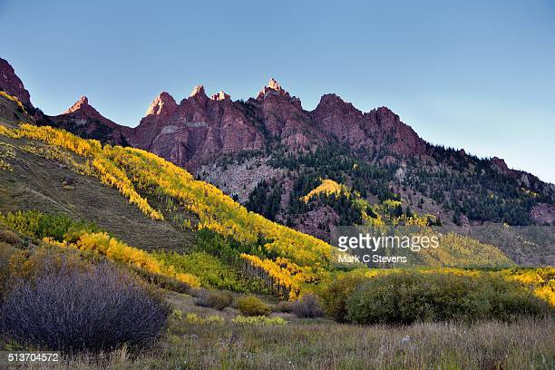 late afternoon sunlight on the peaks of sievers mountain - white river national forest stock photos and pictures