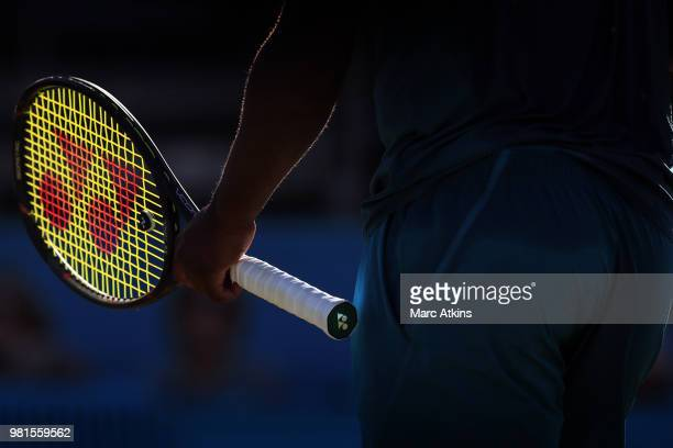 Late afternoon sunlight picks out the detail of a Tennis racket during Day 5 of the FeverTree Championships at Queens Club on June 22 2018 in London...