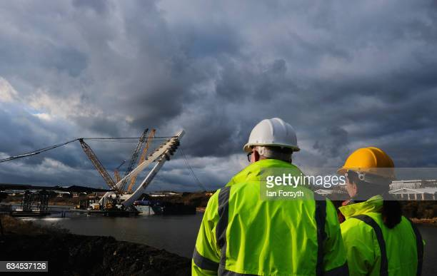 Late afternoon sunlight reflects off the final 100 metre centrepiece of Sunderland's new River Wear crossing as it is lifted into place on February...