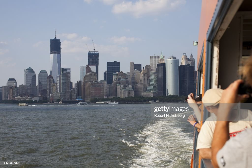 A late afternoon view of the southern tip of Manhattan June 20, 2012 from aboard the Staten Island Ferry after leaving the Whitehall Terminal in New York City's financial district. The new World Trade Tower is in the background.
