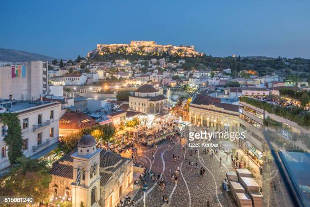 Late aftrennon picture of the famous Monastiraki square, and Acropolis in the background on the hill.  Athens, Greece