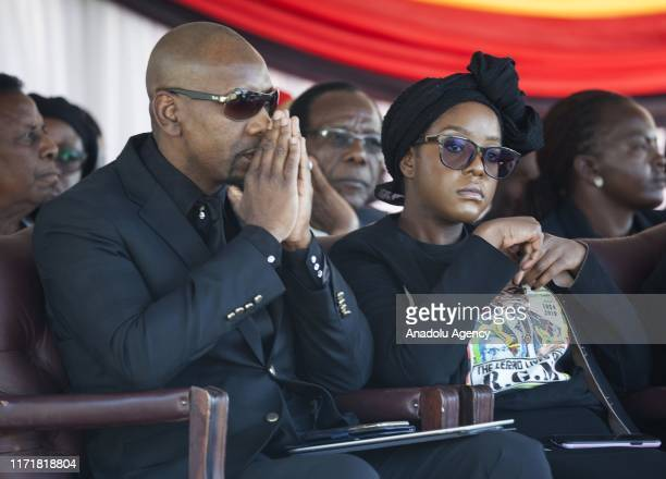 Late and former Zimbabwean president Robert Mugabe's daughter Bona Mugabe and his spouse Simba Chikore watch as the coffin of Mugabe is ready to be...