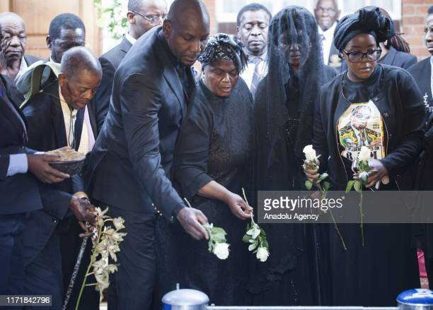 Late and former Zimbabwean president Robert Mugabe's wife Grace Mugabe his daughter Bona Mugabe and her husband Simba Chikore are seen during the...