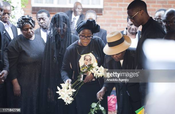 Late and former Zimbabwean president Robert Mugabe's wife Grace Mugabe his daughter Bona Mugabe and his son Robert Peter Mugabe Jr are seen during...