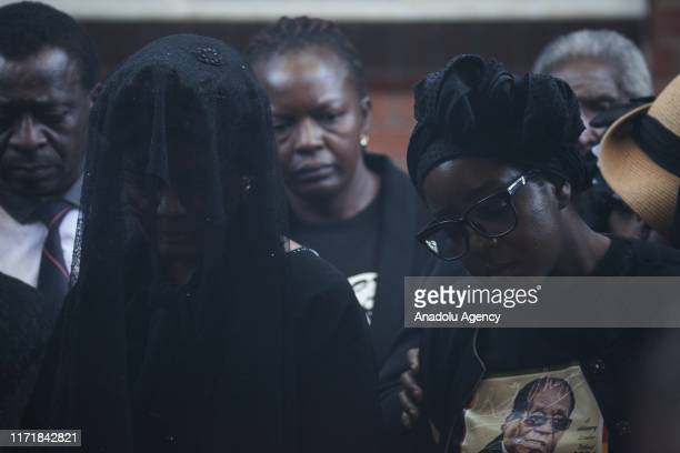 Late and former Zimbabwean president Robert Mugabe's wife Grace Mugabe and his daughter Bona Mugabe are seen during the burial of Mugabe in Harare...