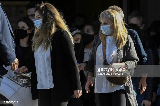 Late Argentine football legend Diego Maradona's daughter, Dalma Maradona , and ex-wife Claudia Villafane leave the Casa Rosada government house to...