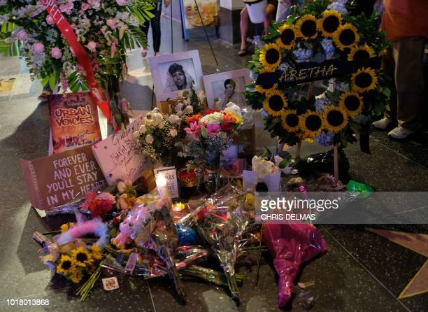 TOPSHOT Late at night people still pay their respect to Aretha Franklin by spending a moment by her Star on the Hollywood Walk of Fame in Hollywood...