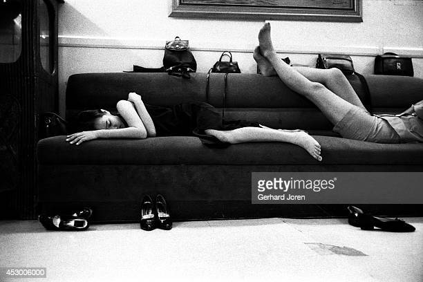 Late at night some young prostitutes who didn't get taken by clients catch up on sleep on a sofa at the brothel where they work At least fifty women...