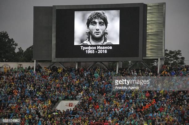 Late Bulgarian international footballer Trifon Ivanov's photo is displayed on a giant screen as Bulgarian football legend Hristo Stoichkov grieves...