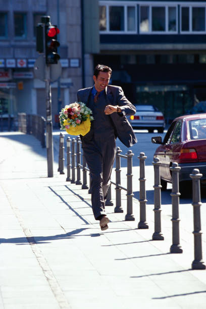 Late Businessman Running with Bouquet