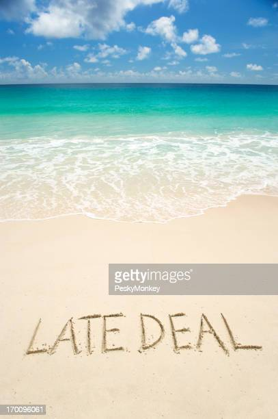 Late Deal Message in Sand on Bright Tropical Beach