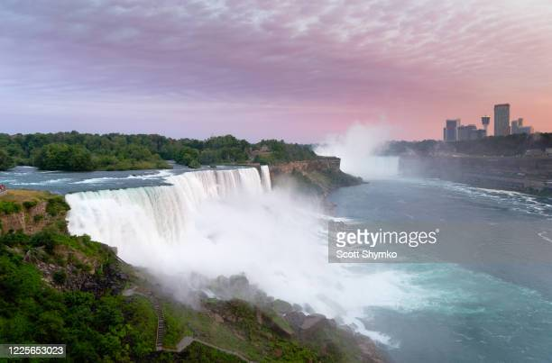 late evening at american falls, niagara, ny - escarpment stock pictures, royalty-free photos & images
