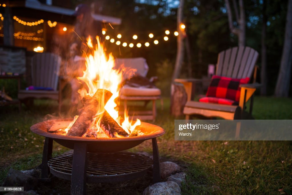Late evening campfire at a beatiful canadian chalet : Stock Photo
