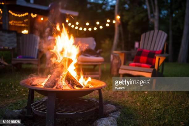 late evening campfire at a beatiful canadian chalet - campfire stock pictures, royalty-free photos & images