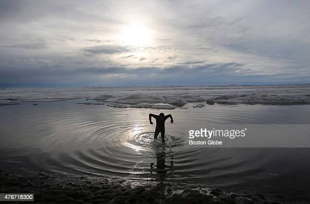 A late evening dunk in the Arctic at Barrow Alaska almost midnight local time with the sun on the horizon for Pawn Patel from India now living in...