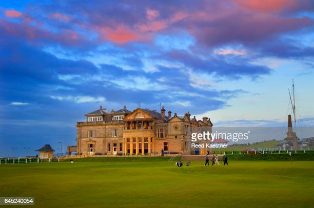 Late evening light illuminates the R&A 'clubhouse' at St Andrews overlooking the 18th green on the 'Old Course'