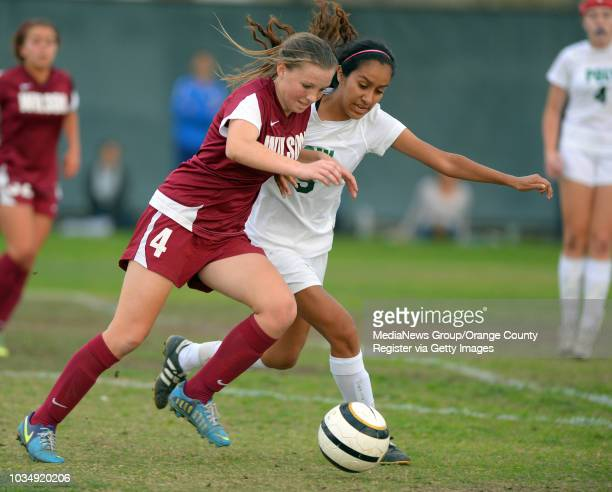 Late in the game Wilson's Sierra Hancock left tries to line up a shot as Poly's Daria Manzano defender her in Long Beach CA on Tuesday January 21...