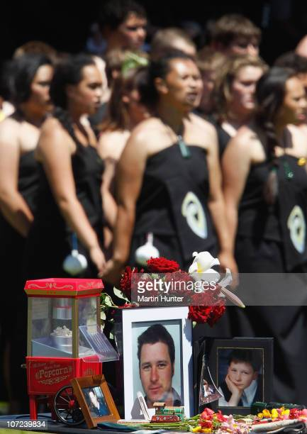 Late miner's personal items and photos are displayed as the Maori Kapa haka group perform at a national memorial service for the 29 miners that lost...