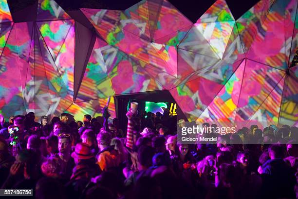 Late night dancing in the Shangri-La section of the Glastonbury Festival. Shangri-La is an immersive art installation based in the idea of a future...