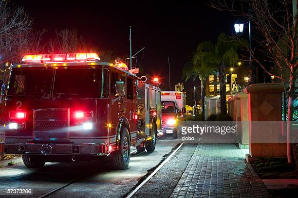 late night emergency in the city - firetruck stock photos and pictures