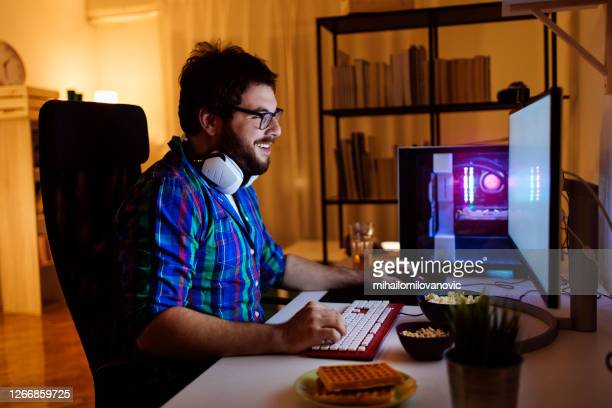late night gaming session - design professional stock pictures, royalty-free photos & images