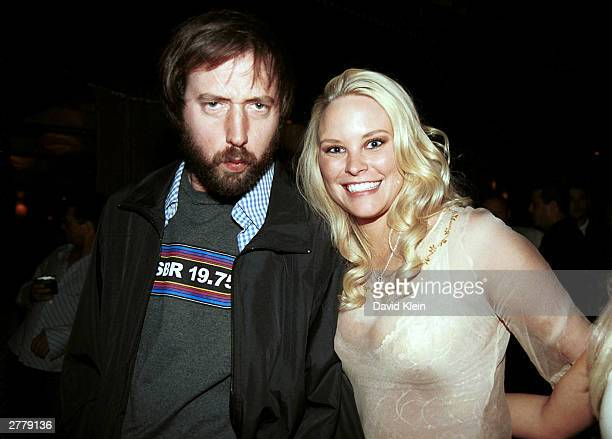 Late Night Host Tom Green and Ms October 2003 Audra Lynn pose at Bliss November 28 2003 in Beverly Hills CA