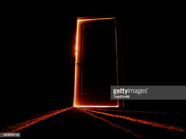 late night image of a slightly open door - deur stockfoto's en -beelden