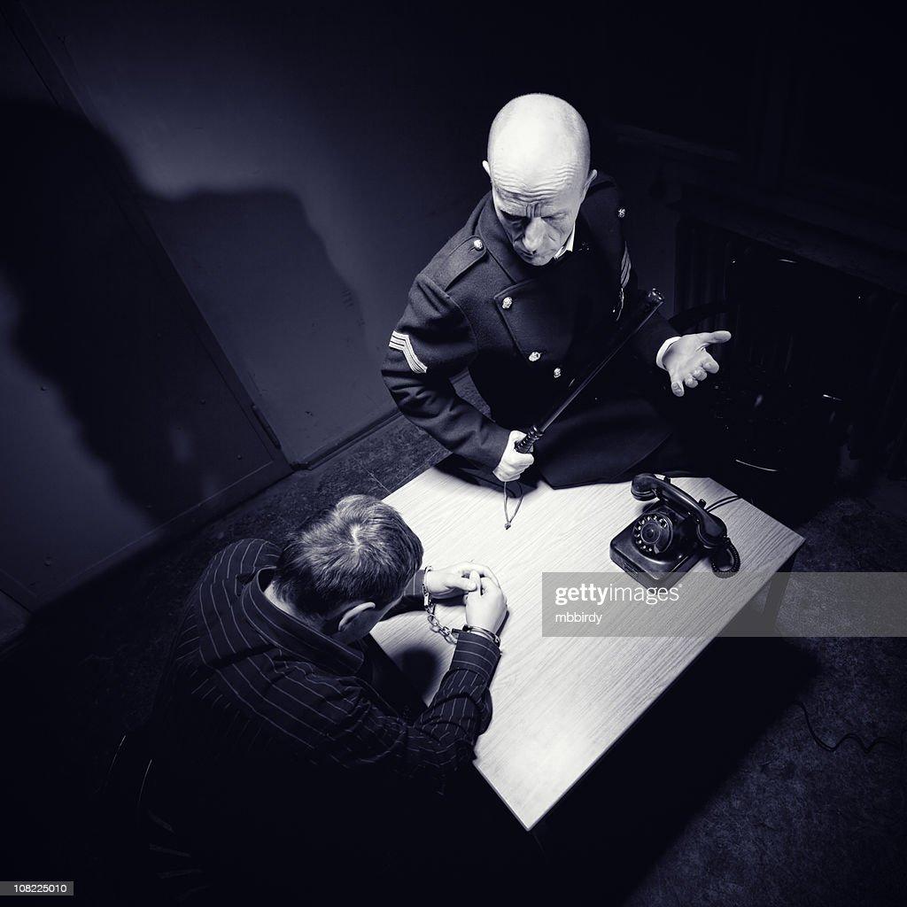 Late night interrogation : Stock Photo