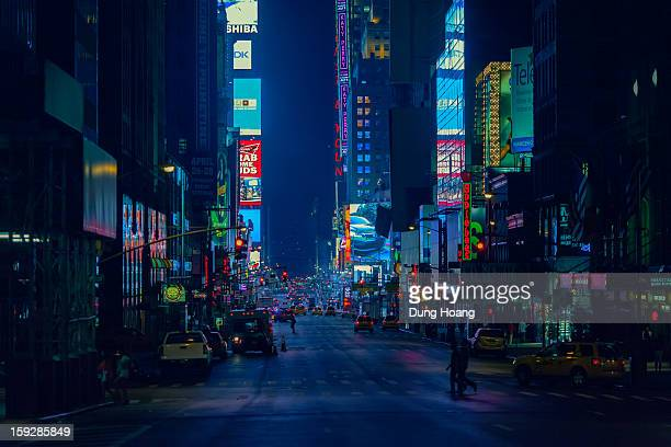 CONTENT] Late night street scene of Times Square Manhattan New York City in blue light from 7th Avenue