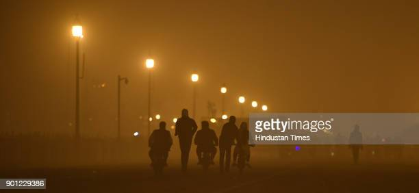A late night view of Rajpath cloaked by heavy fog at late night on January 4 2018 in New Delhi India A thick blanket of fog continued to envelope the...