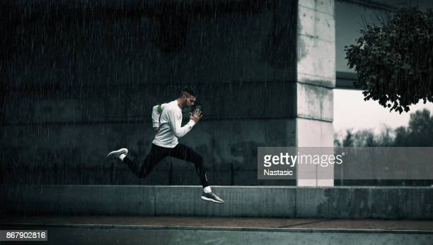 late run - athletics stock photos and pictures