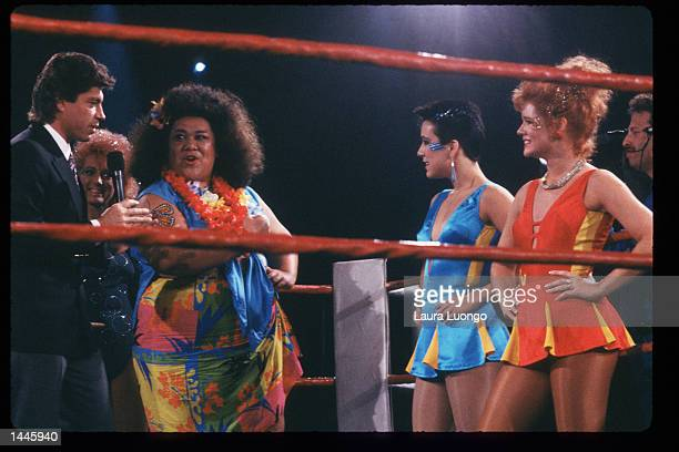 Late Show host Ross Shaffer speaks with members of the GLOW Girls in the ring May 4 1988 in Los Angeles CA Jacqueline Stallone manages the allfemale...