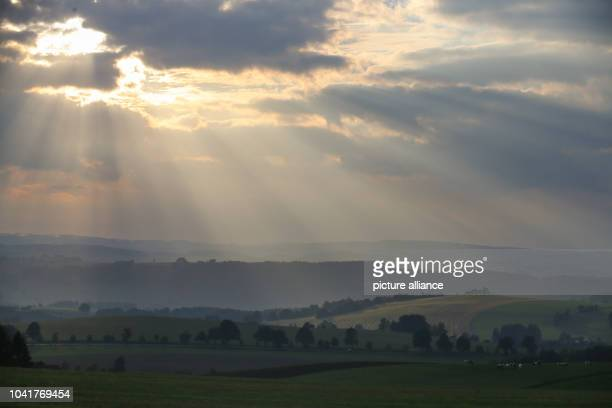 Late sun rays penetrate through the evening clouds over the Erzgebirge in Marienberg Germany 19 September 2016 After the long period of fine weather...