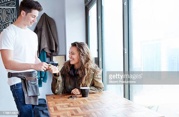 Late teens girl paying with a credit card