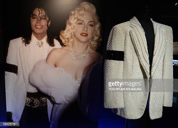 Late US pop star Michael Jackson's 'Academy Awards' jacket is displayed next to a picture of Jackson wearing the jacket as he stands next to pop star...
