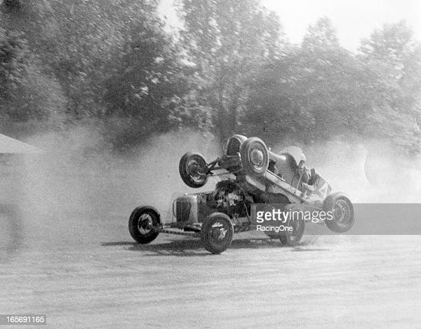 Some wild action during a late-1930s Sprint Car race on a dirt track.