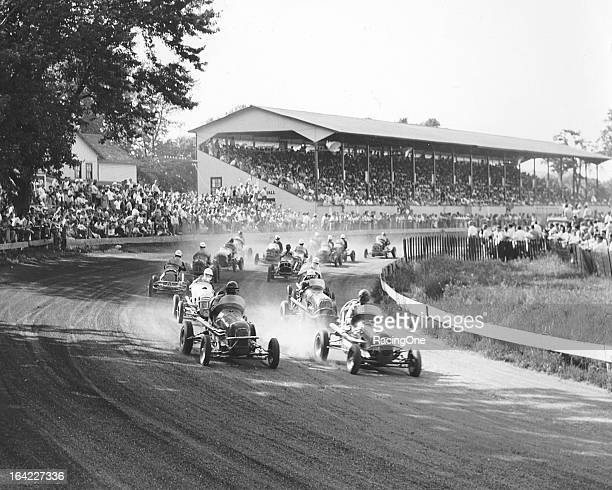 A field of Midget racecars head off into turn one at the start of an event at the Mineola Fairgrounds With the exception of the period during World...